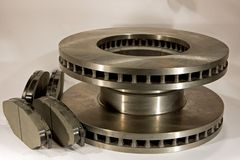 New disc bake rotors and pads. New disc bake rotors and set of brake pads royalty free stock image