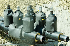 New district heating system pipeline safety valves prepared in the trench.  stock photo