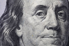 NEW 100 DOLLAR BILL US CURRENCY. Macro closeup of Benjamin Franklin on the new 100 dollar bill USA stock photos