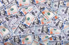 New dollar bills. Pile of one hundred dollar bills new design, background Stock Image