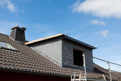 New dormer and scaffolding. Structure at the construction site Stock Photo