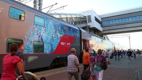 New double-decker train at Kazan Train Station, Moscow. MOSCOW, RUSSIA, 28 AUGUST 2015 - The modern double-decker train named SOCHI 2014 and passengers at the stock video footage