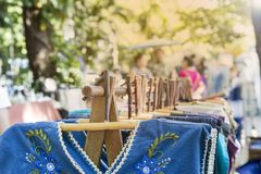 New dress hanging on wooden hanger at Outdoor market in Thailand. Fashion business concept Stock Photography