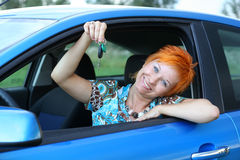 New driver with key from car. New driver with key from new car Stock Photos
