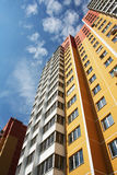 The New dwelling. The Apartment building is brightly painted.Selling the apartments Royalty Free Stock Photo