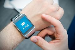 New e-mail notification on smart watch Stock Image