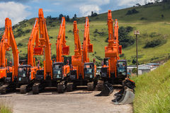 New Earthwork Excavator Machines. Ready for construction earthwork infrastructure buyers Royalty Free Stock Image