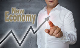 New Economy touchscreen is operated by man Royalty Free Stock Image