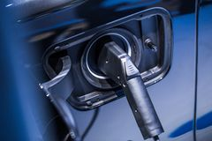 New Electricity Eco Car Battery Power charging. Modern electric vehicle concept Stock Photography