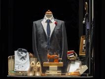New suite on Tailor`s window. New elegant jacket stitching in tailor`s showcase royalty free stock images