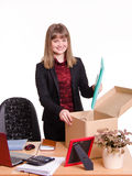 New employee in office puts his things out of box Stock Photography