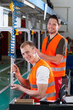 New employee on the production line royalty free stock photo