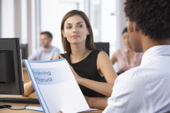 New Employee Starting Work In Busy Office Stock Images
