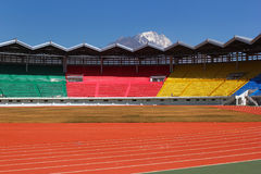 New empty colorful stadium with beautiful mountain in background. Lijiang, China Stock Photo