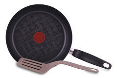 New empty frying pan and spatula Royalty Free Stock Photos