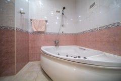 Jacuzzi bath tube. New empty jacuzzi bath tube in bathroom interior royalty free stock photos