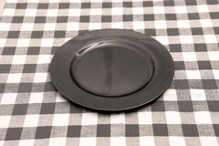 New empty plate. New rounded plate on a table Stock Photo