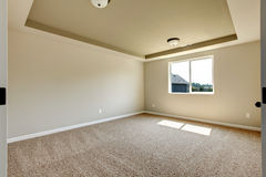 New empty room with beige carpet. Royalty Free Stock Image