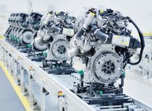 New engines on the line. New manufactured engines on assembly line in a factory Stock Photography