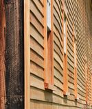 Wavy side of old barn with new siding. New england barn with brown tan sideing middlesex county Massachusetts USA Royalty Free Stock Images