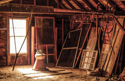 A New England barn loft. This is an unused loft of a working farm which is just a collecting place for things that will never be used again Stock Image