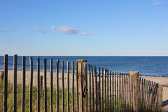 New England Beach Past a Fence Stock Photography