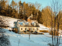 New England Cape-style Home and Winter Sunset With Chimney Smoki Stock Image