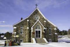 New England Church at Christmas Time. Old stone church in White Mountains of New Hampshire at Christmas time.  Present in image is a creche depicting the Royalty Free Stock Photos