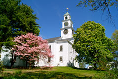 New England Church in Spring. A white clapboard New England church with a clock tower in spring time Stock Image