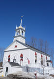 New England church with steeple, in winter Royalty Free Stock Photo