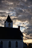 New England Church Sunset. A small town New England church at sunset against a cloudy sky Stock Images