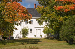New England house in autumn. A New England country house with trees in autumn color. Near Winterport, Maine Royalty Free Stock Photo