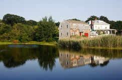 New England House By The Lake Royalty Free Stock Photos