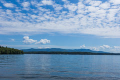 New England lake on bright cloudy blue day. Beautiful ew England lake on bright cloudy blue day stock image