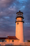 New England Lighthouse bathed in golden light at sunset royalty free stock image