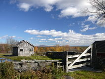New England: maple sugar shack in autumn fall h. New England maple sugar shack in autumn fall with stone wall and gate Royalty Free Stock Photos