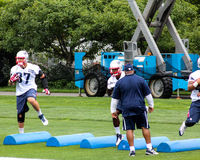 New England Patriots training drills. Rob Gronkowski (87) and other New England Patriots go through drills at training camp stock images