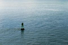 Buoy in Atlantic Ocean surrounded with water stock photo