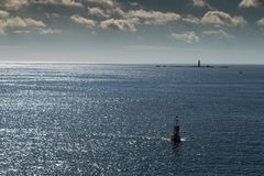 Buoy in Atlantic Ocean with clouds royalty free stock images
