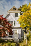 New England traditional house in the fall Stock Photos
