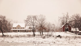 New England Winter. A beautiful winter seen of a country style home and barn in New England Stock Image