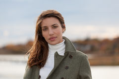 New England Woman During Autumn. An Attractive young woman poses in front of a New England sea side fall/ autumn landscape Royalty Free Stock Photo