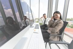 New entrepreneurs are collaborating to innovate in modern office royalty free stock photography