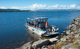 'New Era' at Clachnaharry. Eco friendly solar powered vessel 'New Era' landed at Clachnaharry, Scottish Highlands to let passengers off on 1st October 2016 royalty free stock image