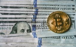 Us dollar bills , bitcoin and Lincoln. New era - crypto currency is here, in full blooming, bitcoin against pile of 100 dollar bills Royalty Free Stock Images