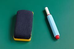 New eraser and chalk holder isolated on blackboard Stock Photography