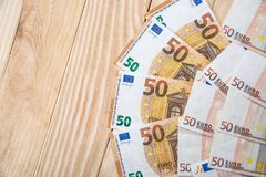 50 new euro banknotes. On wooden desk Royalty Free Stock Photo