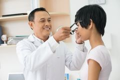 New eyeglasses. Mature optician giving new eyeglasses to female patient Stock Photo
