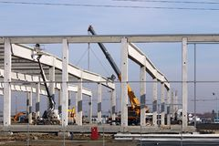 New factory construction site with cranes and workers Stock Photos