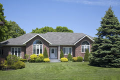 New Family Brick Home. A contemporary family brick home built in the suburbs Stock Photo